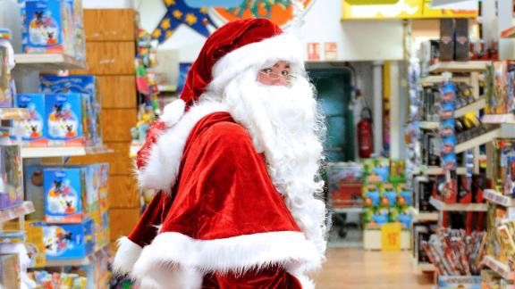 A Santa Claus walks through a toy store in Lille, northern France, on December 15, 2012.
