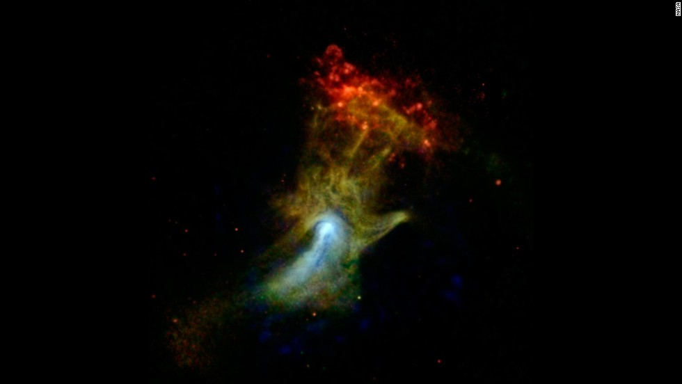 "Is that a giant hand waving at us? Actually, it's what's left of a star that died and exploded a long time ago. Astronomers nicknamed it the ""Hand of God."" <a href=""http://www.jpl.nasa.gov/spaceimages/details.php?id=PIA17566"" target=""_blank"">NASA's Nuclear Spectroscopic Telescope Array, or NuSTAR</a>, took this image in high-energy X-rays, shown in blue. The image was combined with images from another space telescope, the Chandra X-ray Observatory."