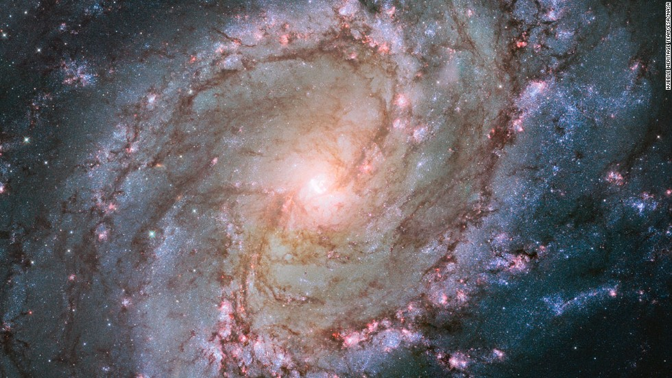 "The Hubble Space Telescope captured this image of the Southern Pinwheel Galaxy, one of the largest and closest galaxies of its kind. <a href=""http://www.spacetelescope.org/news/heic1403/"" target=""_blank"">The center of the galaxy is mysterious</a>, researchers say, because it has a double nucleus -- a supermassive black hole that may be ringed by a lopsided disc of stars, giving it the appearance of a dual core."