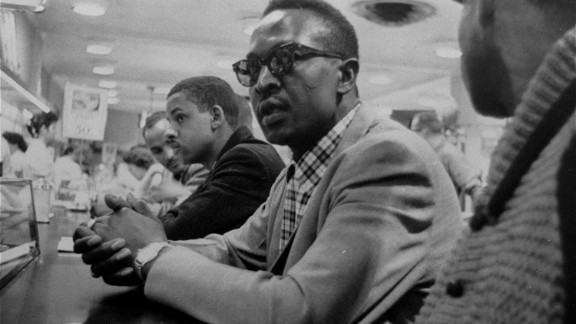 Franklin McCain sits at a lunch counter at a  and three fellow African-American college students made history just by sitting down at a Woolworth