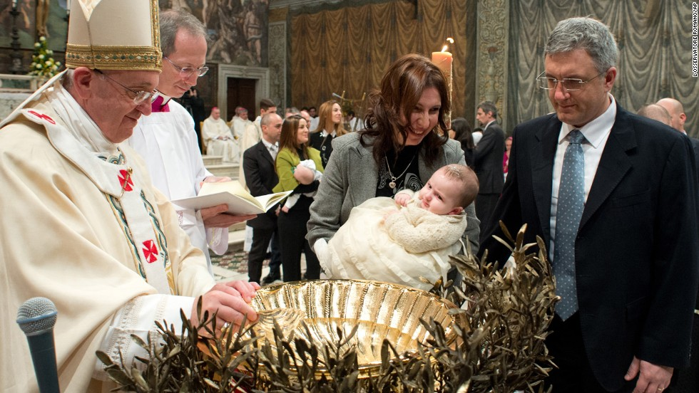 A child is baptized during the ceremony.