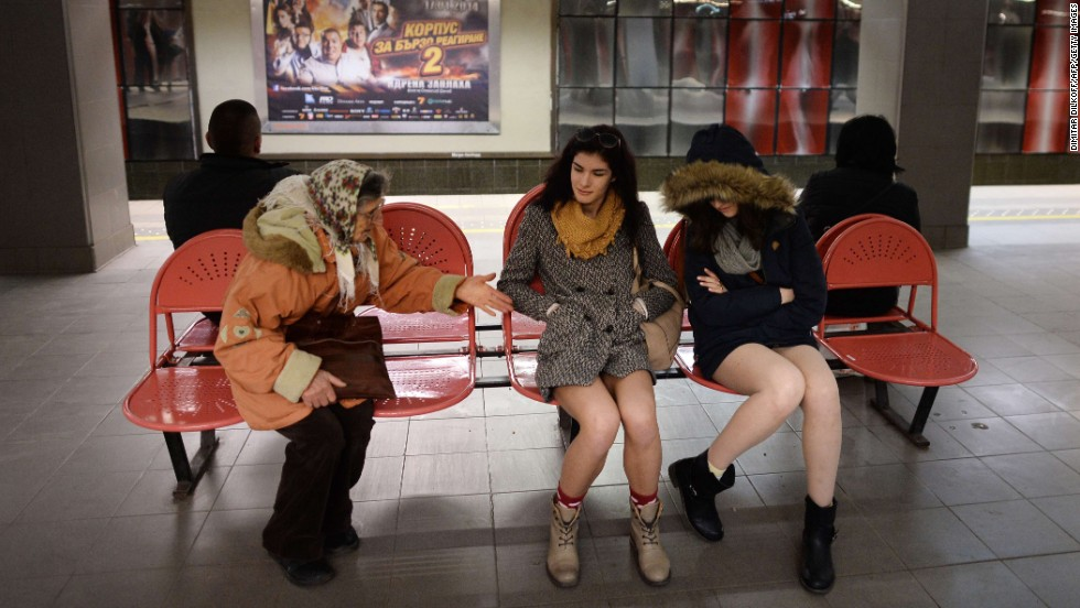 A fully clothed woman talks to women in their underwear at a subway station in Sofia, Bulgaria.