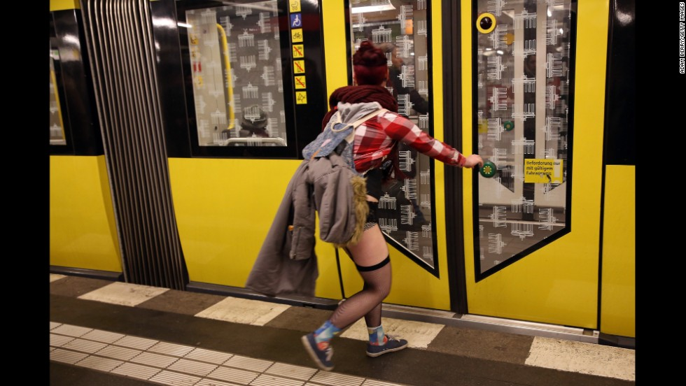 A woman in her underwear rushes to catch a train in Berlin.