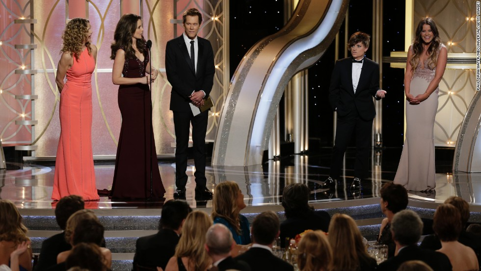 "Kyra Sedgwick, left, and Kevin Bacon, third from left, are interrupted while introducing their daughter Sosie Bacon, right, as this year's Miss Golden Globe. Fey, second from left, jokes that her adult son Randy, played by Poehler, second from right, is Mr. Golden Globe ""in the name of gender equality."""