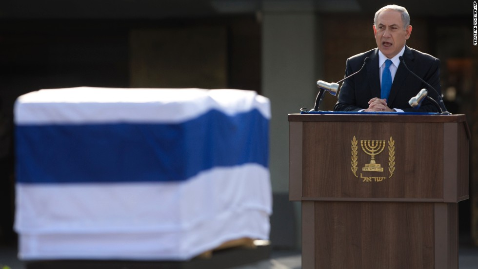 Israeli Prime Minister Benjamin Netanyahu delivers a speech during the service.