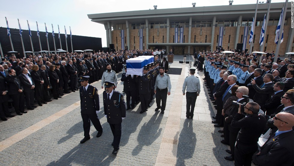 Sharon's casket is carried away from the memorial service outside the Knesset, Israel's parliament.