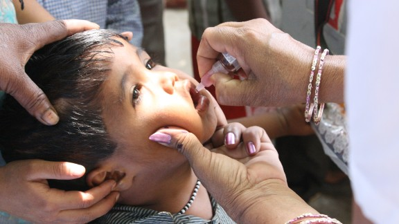 The disabling disease can be prevented with a vaccine. A boy receives an oral vaccine in 2013.