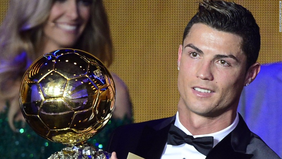 Cristiano Ronaldo raises the Ballon d'Or, after being crowned FIFA's best for the second time in his career.