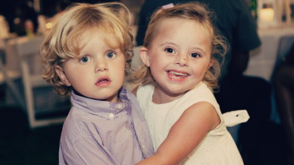 Ellie poses with her younger brother at a recent wedding.