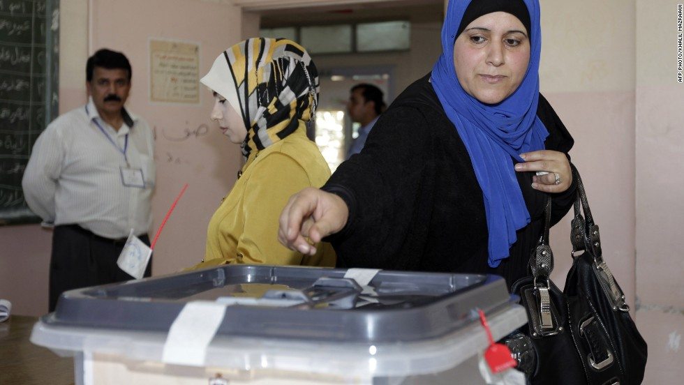 A Jordanian woman casts her ballot for municipal elections at a polling station in Amman on August 27, 2013. The Muslim Brotherhood, the main opposition party, is boycotting the polls, charging that, despite repeated promises since the Arab Spring of 2011, there is no real readiness for change.