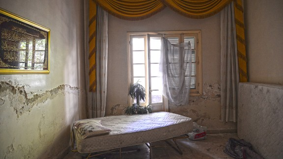 """Italian photographer Matteo Rovella spent June in the Syrian city of Aleppo, capturing the impact of the country's brutal civil war on its population. He was particularly struck by the many destroyed and abandoned homes """"where time seems to have stopped,"""" he said."""