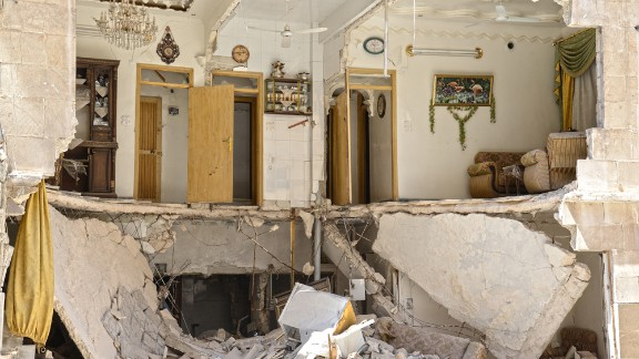 """This picture shows the remains of a Free Syrian Army commander's home. """"The living room was literally sliced in half,"""" he said."""