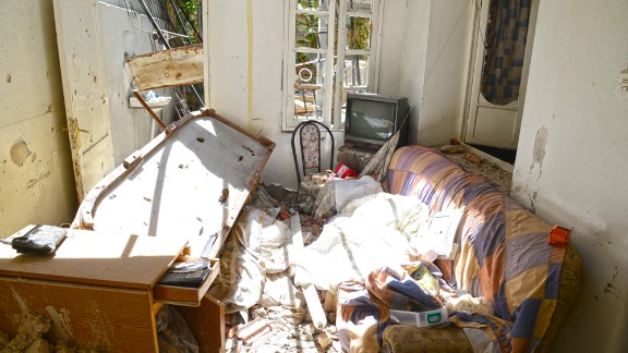 The eerie quality of the photos is striking, with mundane household items strewn amid the rubble of countless battles.