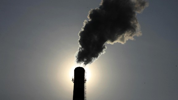 This picture taken on August 14, 2013 shows smoke rising from a chimney at a coal chemical factory in Huaibei, east China's Anhui province. China has soared almost to the top of the world's economic league tables, but whether the official data underpinning its status can be trusted is a constant headache, analysts say.