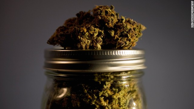 Marijuana strain on top of jar full of strains