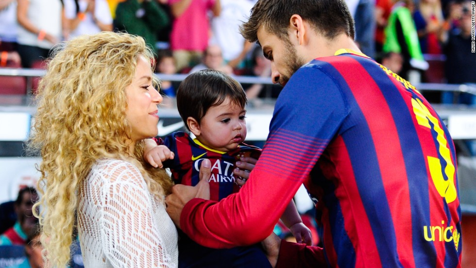 Shakira and Gerard Pique of FC Barcelona are seen with son Milan prior to the La Liga match in 2013. The famous parents live in Spain and are raising their two children, Milan and Sasha, to speak Spanish and English.
