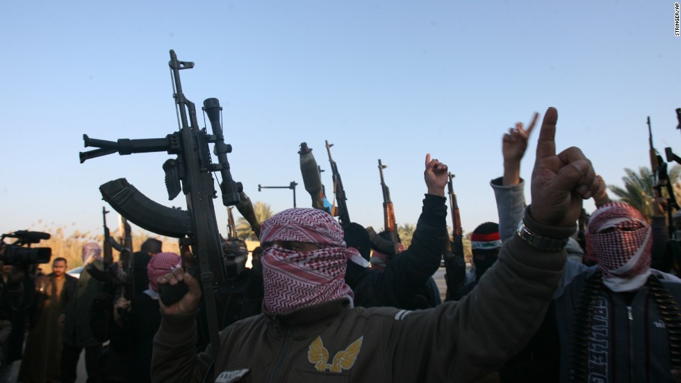 Gunmen protest Iraq's Shiite-led government, demanding that the Iraqi army not try to enter the city of Falluja, on Tuesday, January 7.