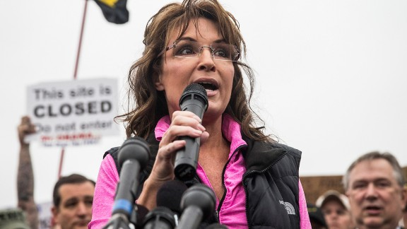 WASHINGTON, DC - OCTOBER 13:  Former Alaskan Governor Sarah Palin speaks at a rally supported by military veterans, Tea Party activists and Republicans, regarding the government shutdown on October 13, 2013 in Washington, DC.  The rally was centered around re-opening national memorials, including the World War Two Memorial in Washington DC, though the rally also focused on the government shutdown and frustrations against President Obama.  (Photo by Andrew Burton/Getty Images)