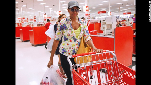 First lady Michelle Obama, wearing a hat and sunglasses, stands in line at a Target in Alexandria, Virginia, on September 29, 2011.
