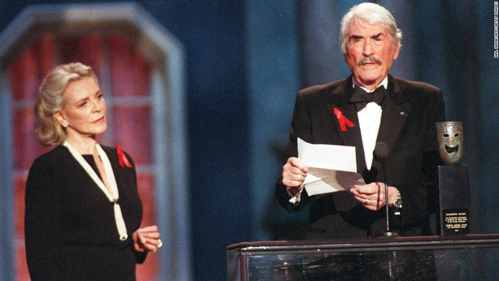 Elizabeth Taylor received the 1997 award. Onstage, Gregory Peck (with Lauren Bacall) read a letter from Taylor, who was recovering from a fall and unable to attend the event.