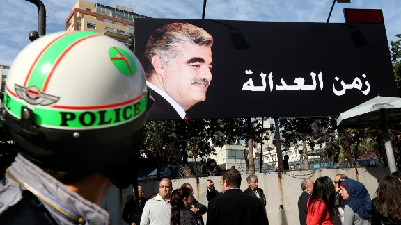 "Supporters of slain former Lebanese Prime Minister Rafik Hariri, gather under a giant billboard with his portrait and Arabic that reads, ""Justice,"" a few hundred of meters (yards) from the site of the 2005 blast, in Beirut, Lebanon, Thursday, Jan. 16, 2014."