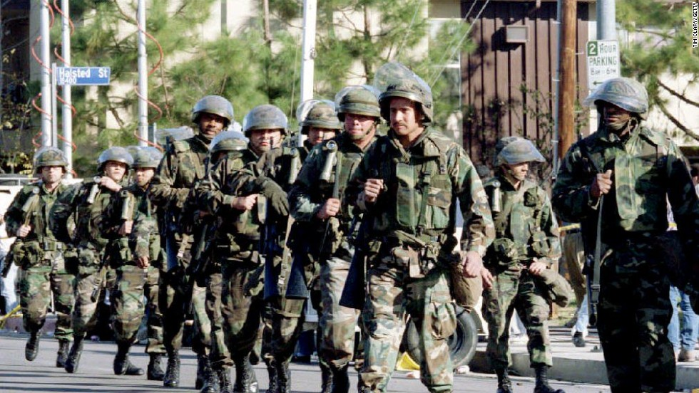 Troops with the California National Guard march in the streets of Northridge to protect areas affected by the earthquake.