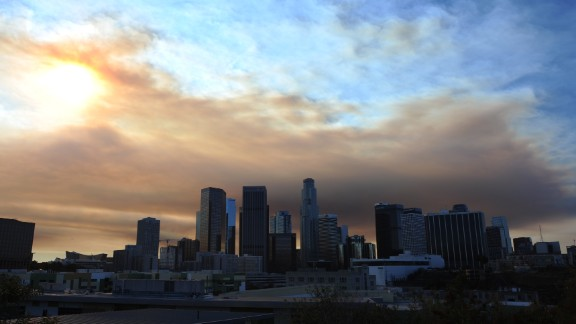 Clouds of smoke from the fire loom over downtown Los Angeles on January 16.