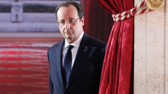 French President Francois Hollande arrives to deliver his speech at his annual news conference, Tuesday, Jan.14, 2014 at the Elysee Palace in Paris. The French president's complex personal life — and what it means to be the first lady in modern society — may get a full airing as Hollande answers questions for the first time since a tabloid reported he was having an affair with an actress. (AP Photo/Christophe Ena)