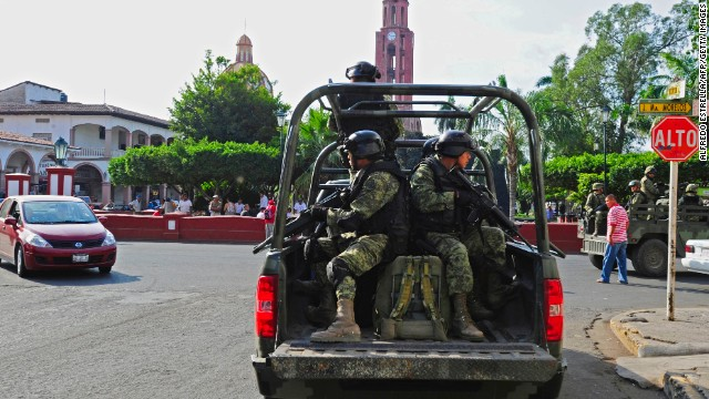 Mexican soldiers patrol the streets of Apatzingan, in Michoacan State, Mexico, on January 16, 2014. On the eve, federal police and army troops said they had 17 cities and towns in western Mexico under control after clashing with vigilantes and seizing Apatzingan (population 120,000) --a bastion of the Knights Templars cartel-- Uruapan (315,000) and Mugica (45,000) among others. The turmoil in Michoacan has become the biggest security challenge for President Enrique Pena Nieto's 13-month-old administration, undermining his pledge to reduce drug violence. AFP PHOTO / ALFREDO ESTRELLA        (Photo credit should read ALFREDO ESTRELLA/AFP/Getty Images)
