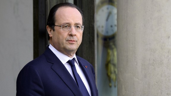French President Francois Hollande waits to meet with Abu Dhabi Crown Prince prior to talks expected to touch on Syria, a week before a major peace conference opens, at the Elysee palace in Paris on January 16, 2014.