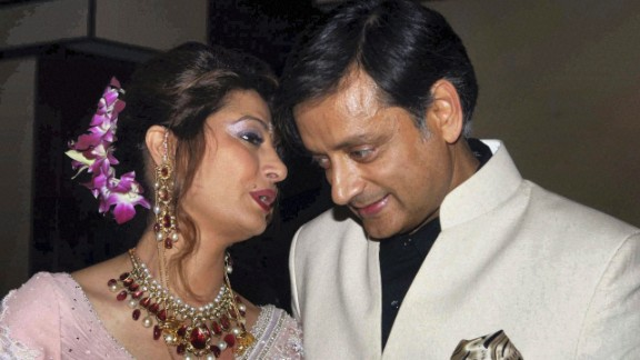 FILE -- In this Sept. 4, 2010 file photo, former Indian Junior Foreign Minister Shashi Tharoor listens to his wife Sunanda Pushkar at their wedding reception in New Delhi, India. Police say on Friday, Jan. 17, 2014, they have found the body of the wife of an Indian federal minister in a New Delhi hotel room after a controversy over her husband's alleged affair with a Pakistani journalist. Officer Rakesh Kumar says police are investigating the cause of Sunanda Pushkar's death. (AP Photo/File)