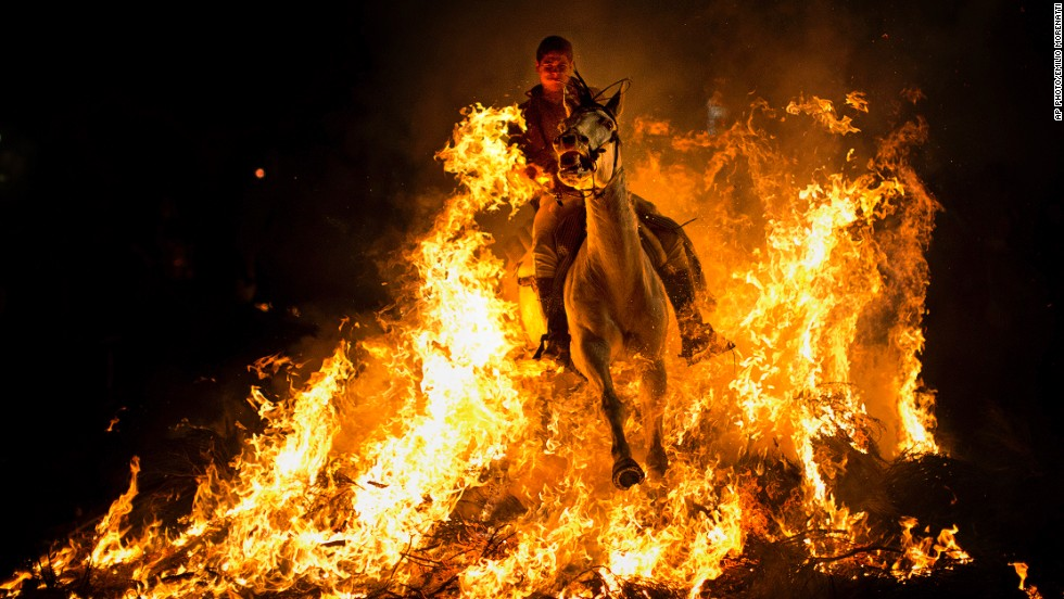 JANUARY 17 - SAN BARTOLOME DE PINARES, SPAIN: A man rides a horse through a bonfire as part of a ritual in honor of Saint Anthony, the patron saint of animals, about 100km (62 miles) west of Madrid on January 16. The 'Luminarias' tradition dates back 500 years and is meant to purify the animals and protect them for the year.