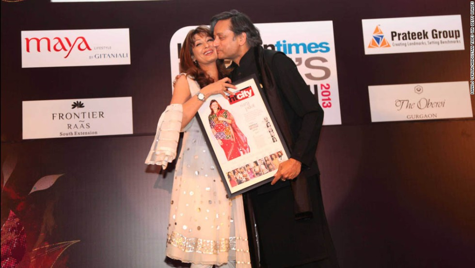 "Indian Human Resources Minister Shashi Tharoor kisses his wife, Sunanda Pushkar, at the ""Delhi's Most Stylish People's Choice Awards 2013"" at the Oberoi Business Hotel on March 21, 2013, in Gurgaon, India. His wife was found dead in a luxury hotel after accusing him of being unfaithful. Her body was taken to the All India Institute of Medical Sciences for examination."
