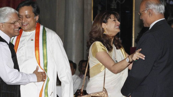 Tharoor and his wife, with Ashwani Kumar, left, and Shiv Shankar Menon, attend a swearing-in ceremony for new ministers at Rashtrapati Bhavan, the Indian President
