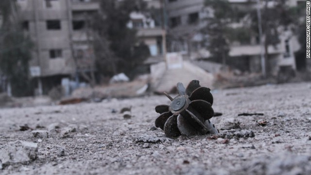 The remains of a mortar are seen in a street of the Syrian city of Daraya, located southwest of the capital Damascus, on January 17.