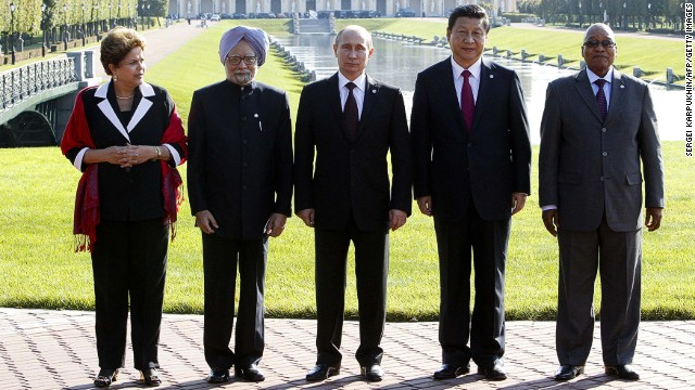 (From L) Brazil's President Dilma Rousseff, India's Prime Minister Manmohan Singh, Russia's President Vladimir Putin, China's President Xi Jinping and South African President Jacob Zuma pose for a photo after the BRICS leader's meeting at the G20 summit on September 5, 2013 in Saint Petersburg.