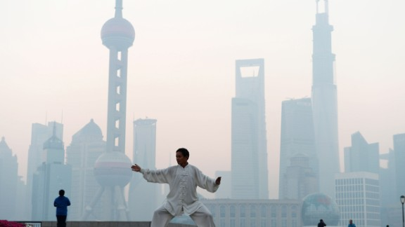 A man practices Tai Chi in Shanghai as heavy smog engulfs the city on November 7, 2013. In 2010, 40% of the world's premature deaths caused by air pollution were in China, according to a survey published in the Lancet.