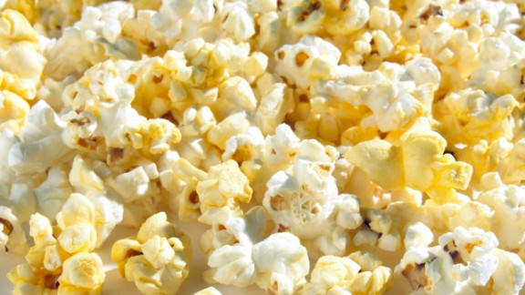 "Popcorn  This movie-night fave is a low-energy-density food -- for 90 calories, you could eat 3 cups of air-popped corn but just a quarter cup of potato chips. ""Popcorn takes up more room in your stomach, and seeing a big bowl of it in front of you tricks you into thinking that you're eating more calories and that you'll feel full when you're finished,"" Rolls says.  Feel even fuller: Sprinkle on some red pepper. In a recent Purdue University study, people who added a half teaspoon of the spice to a meal felt less hungry.  Health.com: 16 ways to lose weight fast"