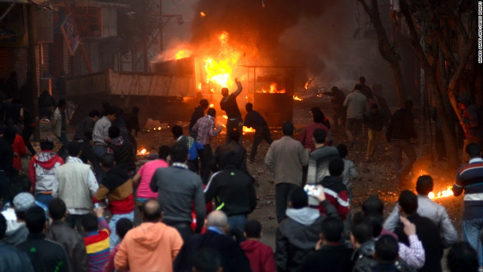 Protesters and Egyptian riot police clash in Cairo on January 17, as the country awaits the results of a constitutional referendum. On January 18, the electoral commission announced the constitution had overwhelmingly been approved.
