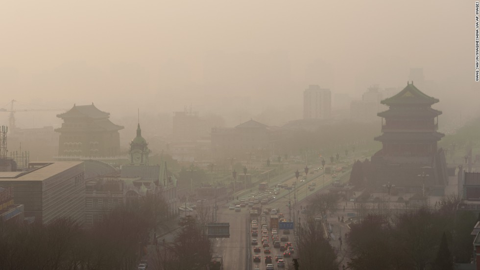 "Vehicles move slowly through heavy smog in Beijing on Thursday, January 16. China's manufacturing of exports generates pollution that harms air quality -- not only in Asia but also all the way across the Pacific Ocean in the <a href=""http://www.cnn.com/2014/01/20/health/pollution-china-pnas/index.html"">Western United States</a>, according to a new study."