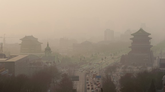 Vehicles move slowly through heavy smog in Beijing on Thursday, January 16. China's manufacturing of exports generates pollution that harms air quality -- not only in Asia but also all the way across the Pacific Ocean in the Western United States, according to a new study.