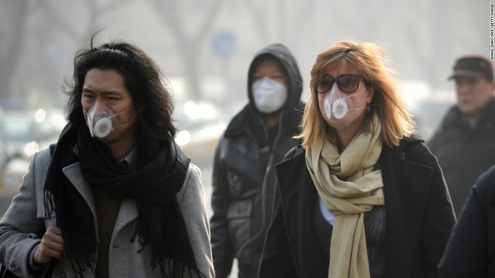 "People use face masks during their commute in Beijing on January 16. The Chinese government is trying to control the number of new vehicle registrations this year in some cities to help improve air quality, <a href=""http://money.cnn.com/2014/01/20/autos/china-autos-pollution/"">CNNMoney reports</a>."