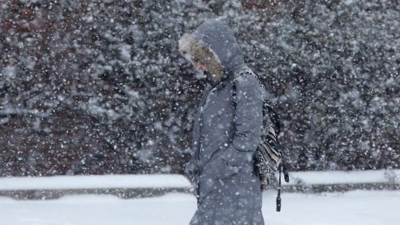 A woman walks through a snow storm on January 21 in south Philadelphia.