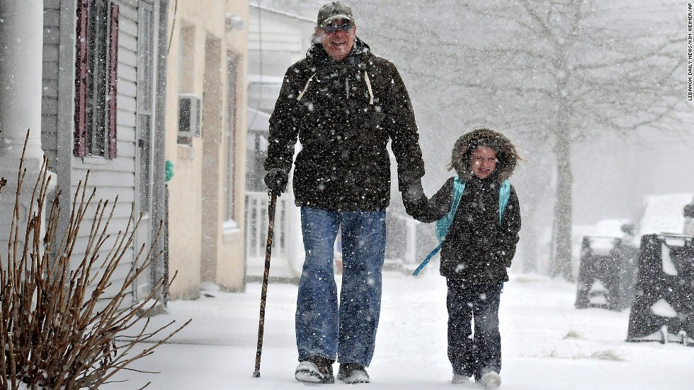 Tony Ciambrello and his granddaughter Addie Maurer walk home from St. Mark's Catholic School in Bristol Borough, Pennsylvania, on January 21.