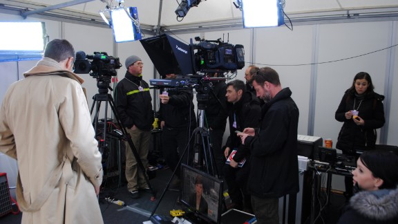 Quest talks to crew as he prepares for his first live broadcast from Davos, where the World Economic Forum is being held.