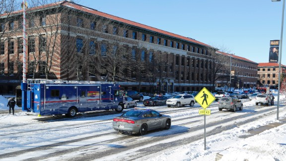 Police lock down the area after shots were fired on Tuesday, January 21, on the campus of Purdue University in West Lafayette, Indiana. The shooting was reported at an electrical engineering building, Purdue says