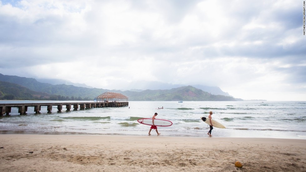 A cloudy day on the beach of Hanalei Bay. Pros love it for its overhead tubes and consistently fine waves, others just love the super-chill vibe of a perfect beach town.