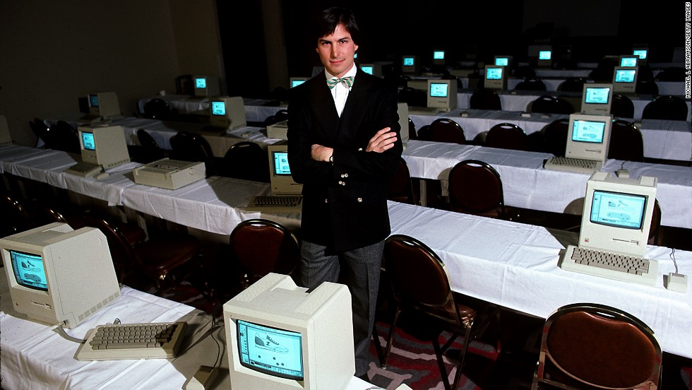 Jobs poses in 1984 with a room full of original Macintoshes. The machine packed 128K of memory -- tiny by today's standards -- and sold for $2,495.