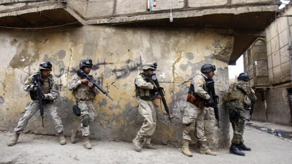 Iraqi army special forces patrol Baghdad's al-Fadel district on March 30, 2009.