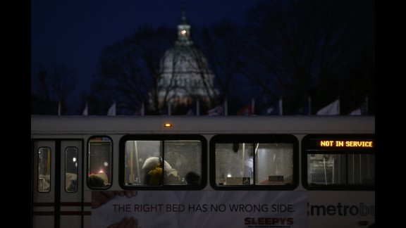 People sleep inside a Metrobus parked at Union Station in Washington on January 22. The bus was designated a warming station for the homeless.